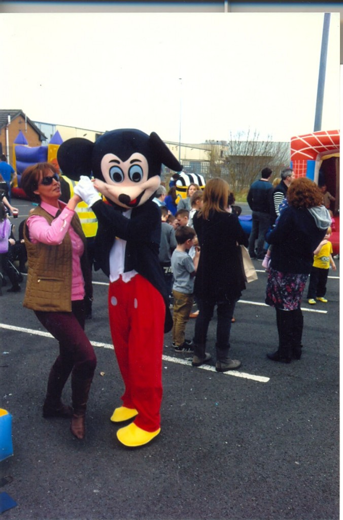 Karen Murphy having a dance with Mickey Mouse.